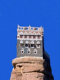 Dar Al-Hajar (Ar. دار الحجر- literally 'Abode of Rock', 'House of Stone'), is located in Wadi Dhahr, about 14km (9 miles) northwest of Sana'a. Situated on a rocky outcrop near the centre of the valley, Dar al-Hajar - the 'Rock Palace; - was a summer retreat for the hereditary imams of Yemen, dating back at least as far as 1786, when it was built on the instructions of  Imam Mansour Ali Bin Mehdi Abbas.<br/><br/>  Although there are indications that the site may have been inhabited for many centuries, Dar al-Hajar in its present form dates from the reign of Imam Yahya in the 1930s. Standing five stories tall, it is open to the public and houses a small museum.