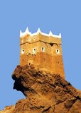 Al-Ghowaizi Fort, Tower or Castle (Husn Al-Alghwayzi حصن الغويزي) is located on the western outskirts of Al Mukalla (Arabic: المكلا Al Mukallā), the main sea port and the capital city of the Hadramaut coastal region of Yemen in the southern part of Arabia on the Gulf of Aden close to the Arabian Sea.<br/><br/>  It is located 480 km (300 mi) east of Aden and is the most important port in the Governorate of Hadramaut, the largest governorate in South Arabia. Al Mukalla is the fourth largest city in Yemen with a population of approximately 300,000. The city is served by the nearby Riyan Airport.